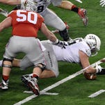 Jan 12, 2015; Arlington, TX, USA; Oregon Ducks defensive lineman Alex Balducci (56) recovers a fumble for possession during the second quarter against the Ohio State Buckeyes in the 2015 CFP National Championship Game at AT&T Stadium. Mandatory Credit: Jerome Miron-USA TODAY Sports