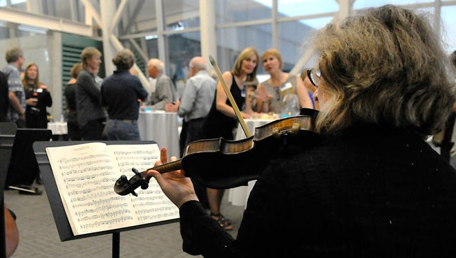 Jennifer Wildeson, Violin I, preforms with the Saint Cloud String Quartet on Saturday  during The Eckblad Williams Community Fund at the Gray Plant Mooty building.