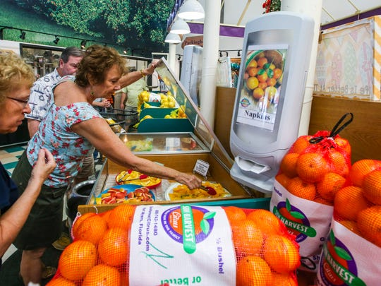 Bonnie Greenoe of Fort Myers samples some of the fruit