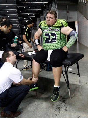 Northern Kentucky River Monsters quarterback Jared Lorenzen is checked by medical staff after he suffered an ankle injury.