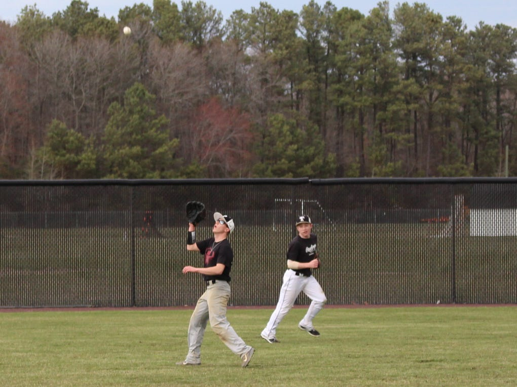 Sussex Tech senior Trey Banning shags a fly ball during practice in Georgetown.