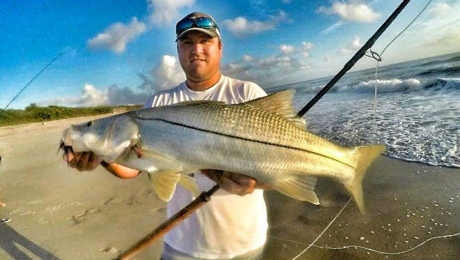 Steve Stewart used fly rod tackle to catch and release this ocean-going snook in the surf south of Melbourne Beach. This is the time of the year when big snook are on the move along area beaches in search of baitfish. Stewart and his girl friend, artist Lindsay Rowland, were casting flies during a high tide. They are members of the Backcountry Fly Fishing Association of Brevard.