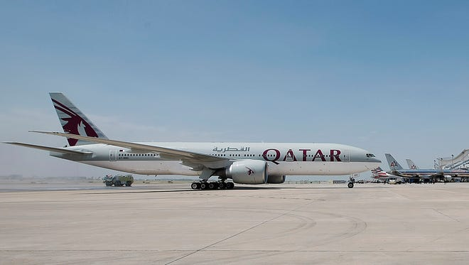 This file photo from July 1, 2014, shows a Qatar Airways 777-200 at Dallas-Fort Worth International Airport.