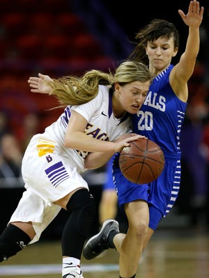 Assumption's Autumn Linzmeier (right) defends against Barneveld's Hannah Whitish during Saturday's WIAA Division 5 girls' state basketball final at the Resch Center in Ashwaubenon.
