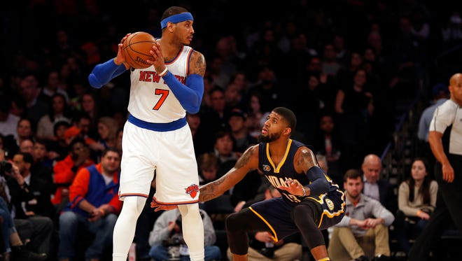 New York Knicks forward Carmelo Anthony (7) is defended by Indiana Pacers forward Paul George (13) during the second quarter at Madison Square Garden.