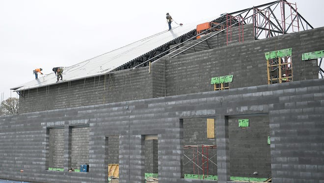 Construction crews work on building Jordan Elementary, a new school on Split Log Road in Brentwood.
