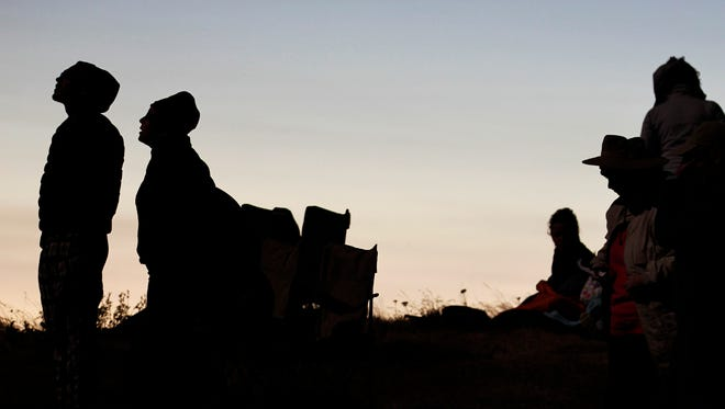 Spectators watch the end of solar eclipse totality from atop Marys Peak in Siuslaw National Forest on Monday, Aug. 21, 2017.