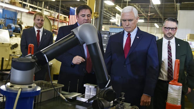 U.S. Vice President Mike Pence takes a tour Saturday, Nov. 4, 2017, at Military & Commercial Fasteners Corp. in Manchester Township, York County, Pennsylvania. U.S. Vice President Mike Pence visited the plant with U.S. Secretary of Labor Alex Acosta and U.S. Rep. Scott Perry, R-York County, to promote President Donald Trump's tax reform plan.