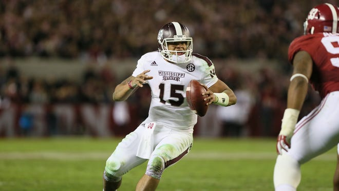 MSU quarterback Dak Prescott (15) looks for running room near the goal line as time winds down in the fourth quarter. Mississippi State played Alabama in a college football game on Saturday, November 15, 2014 at Bryant Denny Stadium in Tuscaloosa, Ala. (Photo by Keith Warren)
