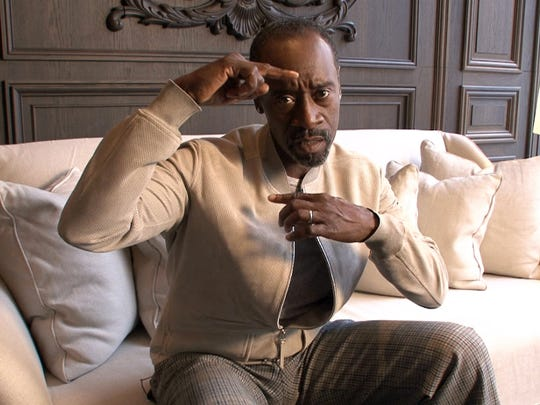 """Don Cheadle talks about framing a shot during an interview in New York City Thursday, March 24, 2016, in advance of his appearance at the Asbury Park Music in Film Festival where his movie """"Miles Ahead"""" will be screened."""