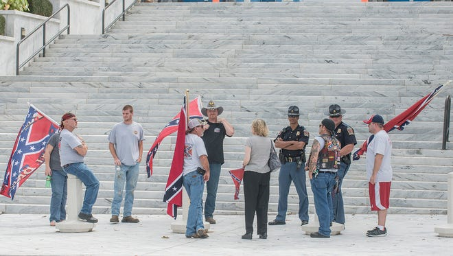 "The Alabama Flaggers, a pro-Confederate battle flag group, held a rally Saturday, Aug. 29, 2015, in Montgomery, Ala., to protest continued efforts to take down the flag. The ""Southern heritage"" organization invited people to join them on the steps of the Alabama Capitol to demand secession from the United States."