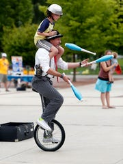 Comedy juggler Ned Gelfars performs at the 42nd annual