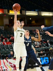 Michigan guard Katelynn Flaherty lays the ball up past Penn State guard Siyeh Frazier on Thursday.