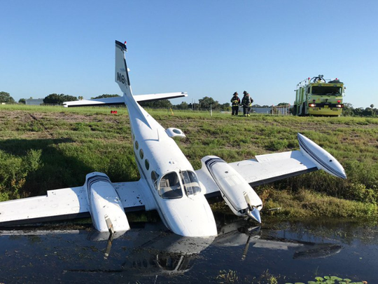 Plane lands in ditch at Orlando Executive Airport.