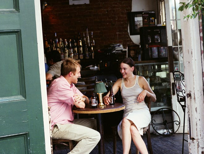 Stock photo of couple having drinks in restaurant, open door in foreground in New Orleans, LA Credit: Brooke Slezak, Getty Images GETTY ID#: 10193744  Rights-managed. Additional uses need to be licensed.