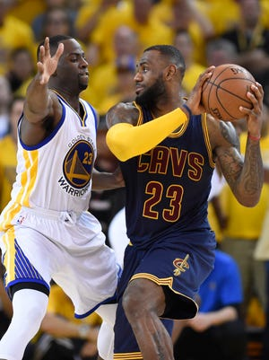 Jun 14, 2015; Oakland, CA, USA; Cleveland Cavaliers forward LeBron James (23) handles the ball against Golden State Warriors forward Draymond Green (23) during the fourth quarter in game five of the NBA Finals at Oracle Arena. Mandatory Credit: Bob Donnan-USA TODAY Sports
