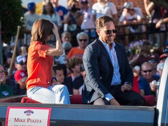 In Cooperstown, N.Y., Hall of Fame member Mike Piazza arrives at National Baseball Hall of Fame for his induction.
