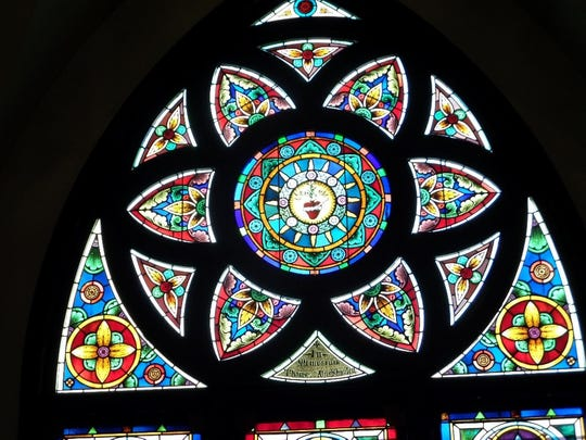 One of two six-petaled rose windows facing each other inside the church.
