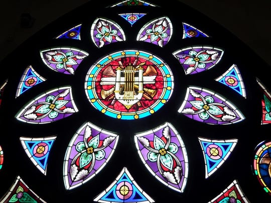 The largest window in the church is the eight-petaled rose window with a musical theme.