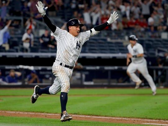 Yankees' Ronald Torreyes gestures as he runs to first