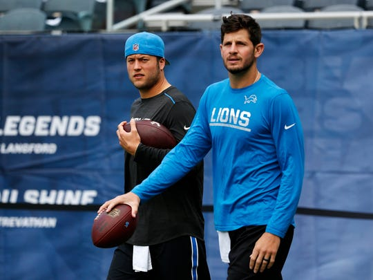 Lions quarterbacks Matthew Stafford, left, and Dan Orlovsky walk on the field for warm-ups before the game against the Chicago Bears, Sunday, Oct. 2, 2016, in Chicago.