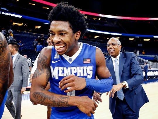 Memphis guard Kareem Brewton Jr. (left) is congratulated