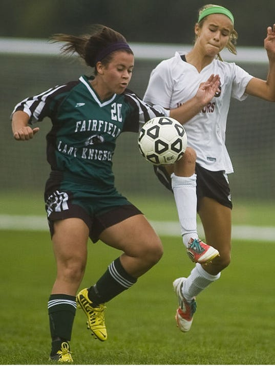 Fairfield's Makensy Peiffer (20) battles Gettysburg's Emily Bertram for the ball Saturday afternoon. The Green Knights won, 6-1. (Shane Dunlap -- The Evening Sun)