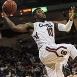 South Carolina guard Duane Notice (10) attempts to save the ball from going out of bounds during the second half of an NCAA college basketball game Wednesday, Feb. 24, 2016, in Columbia.