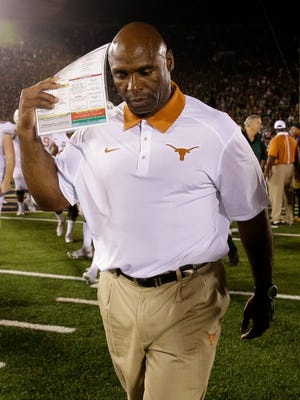 Texas head coach Charlie Strong walks off the field after team's 38-3 loss to Notre Dame in an NCAA college football game Saturday, Sept. 5, 2015, in South Bend, Ind. (AP Photo/Nam Y. Huh)