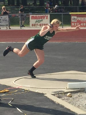 Newark Catholic senior Mary-Brigid Keck competes in the shot put Thursday during the Division III district meet at Watkins Memorial.