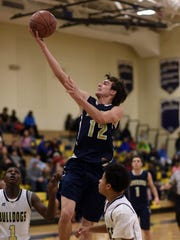 Our Lady of Lourdes High School's Luke Timm flies to the hoop against Beacon on Dec. 11 in Beacon.