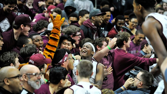 U-D Jesuit players including Cassius Winston, center, celebrate with the fans after the win over North Farmington in the Class A boys basketball finals at the Breslin Center in East Lansing on March  26, 2016.