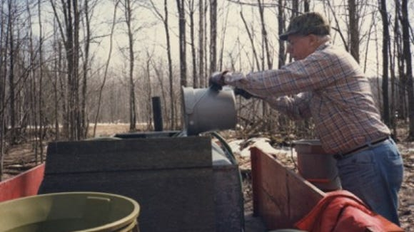 Laurence Bruggers collecting sap in Michigan in the early 1980s.