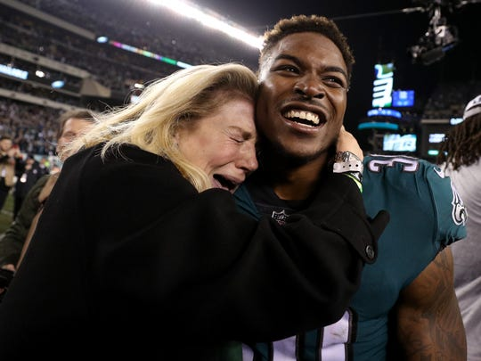 Eagles running back Corey Clement is hugged by a fan