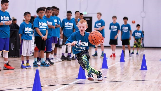 A boy shows his dribbling skills at a junior NBA Skill Challenge. The National Basketball Association and the village Parks and Recreation Department will stage a junior NBA Skills challenge from 9 a.m. to 4 p.m., with any tie breakers at 4:15 p.m., Feb. 10, at Horton Gymnasium. Competition.