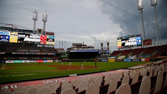 Storm clouds roll past the ballpark in the third inning of the MLB National League game between the Cincinnati Reds and the Pittsburgh Pirates at Great American Ball Park in downtown Cincinnati on Friday, Aug. 14, 2020. The Reds led 3-1 after four innings behind two home runs by designated hitter Jesse Winker.