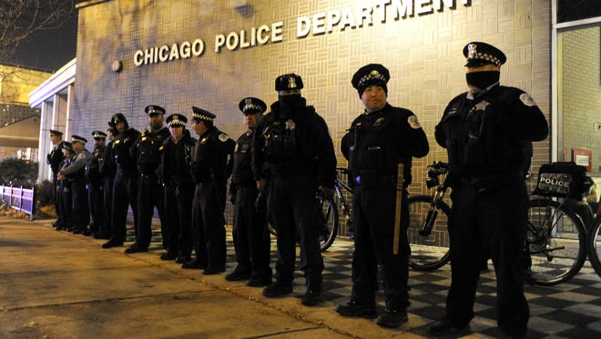 Chicago police officers line up outside the District 1 central headquarters at 17th and State streets, Tuesday, Nov. 24, 2015, in Chicago.