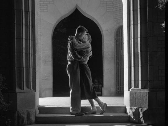 "A 1950 photo of a pair of Iowa State students kissing under the Campanile, from ""Campus Beautiful,"" a new book about the school's history."
