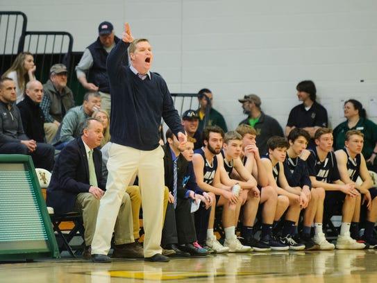 MMU head coach Jeff Davis talks to his team during