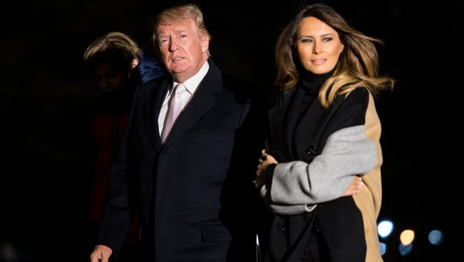 President Trump and first lady Melania Trump return to the White House following a weekend trip to Mar-a-Lago, on Jan. 15, 2018.