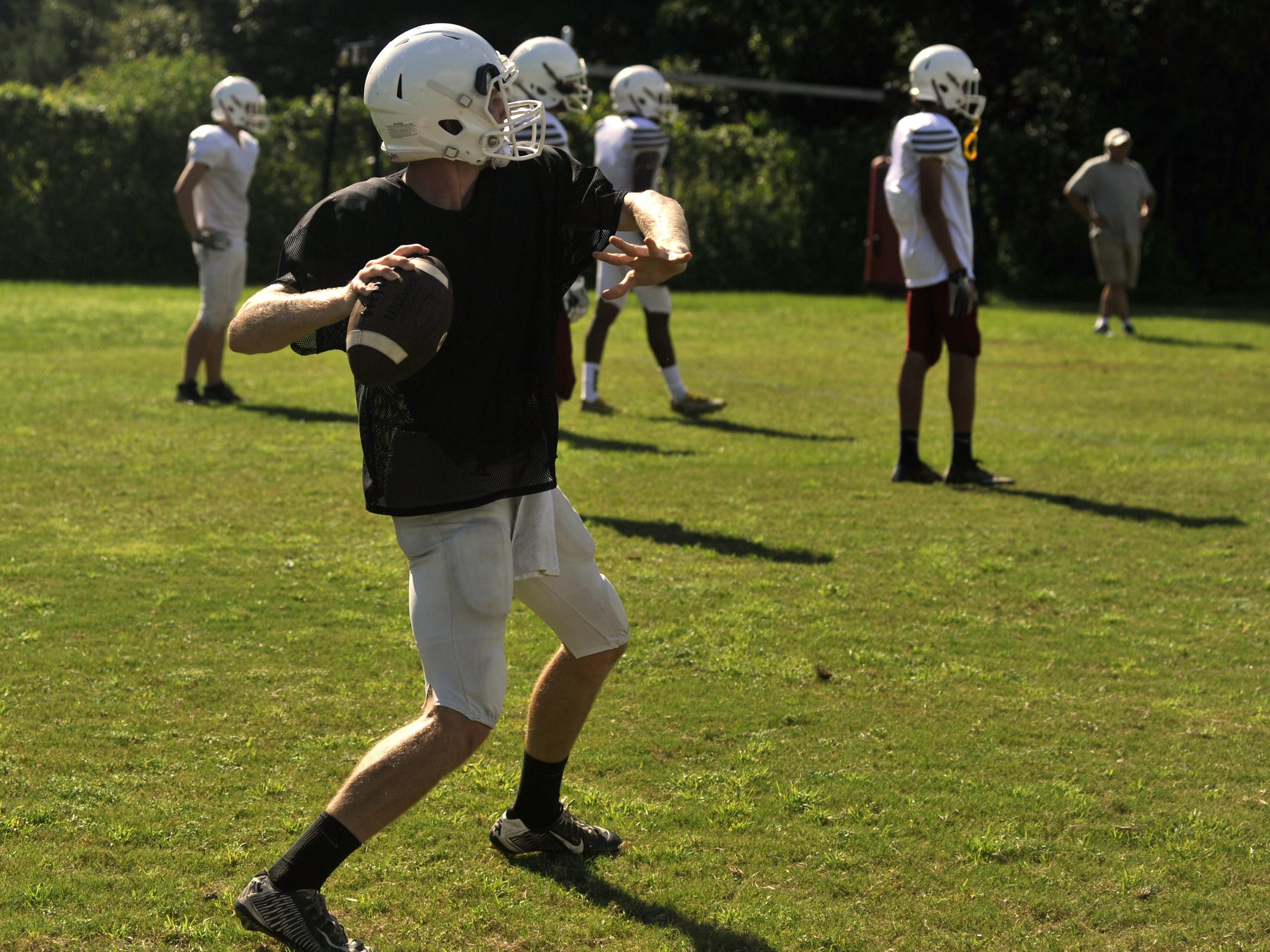 Tate starting quarterback Jake Henry throws a pass during practice on Aug. 16, 2016.