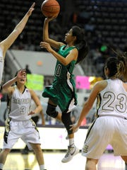 May's Yary Rodriguez (10) puts up a shot over O'Donnell defenders during the first quarter of May's 61-43 loss in the Region II-A regional semifinal on Friday, Feb. 24, 2017, at Moody Coliseum in Abilene.