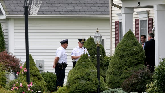 """Charles Tan's defense attorneys open the Tan home on Coach Side Lane in Pittsford to court deputies to conduct a security sweep before jurors were allowed inside. The jurors viewed the upstairs office where Liang """"Jim"""" Tan, 49, was found dead Feb. 9, 2015."""