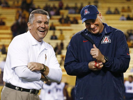 ASU coach Todd Graham talks with Arizona's Rich Rodriguez