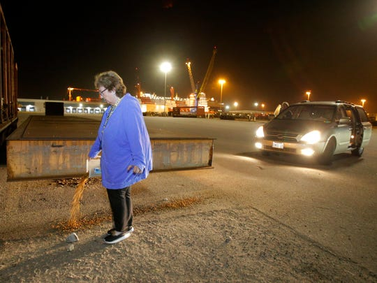 Bonnie Thaanum distributes food for the hundreds of feral cats that make the Port of Hueneme their home.
