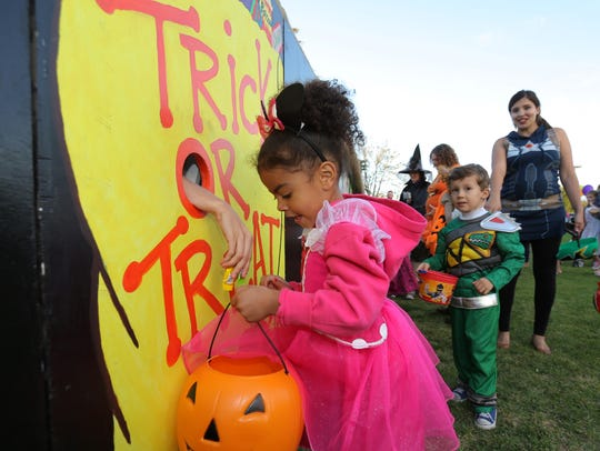 Zoie Lee, 3, of Camarillo, receives candy from a mysterious hand at the Trick-or-Treat Village during a past Halloween at the Park event, sponsored by the Pleasant Valley Recreation and Park District. This year's event will be from 5-8 p.m. Oct. 31 at the Camarillo Community Center.