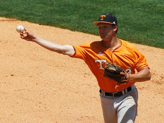 FILE - In this May 20, 2014, file photo, Tennessee's Nick Senzel  throws back to first during the seventh inning against Vanderbilt at the Southeastern Conference NCAA college baseball tournament  in Hoover, Ala. Senzel is a top prospect in the Major League Baseball draft. (AP Photo/Butch Dill, File)