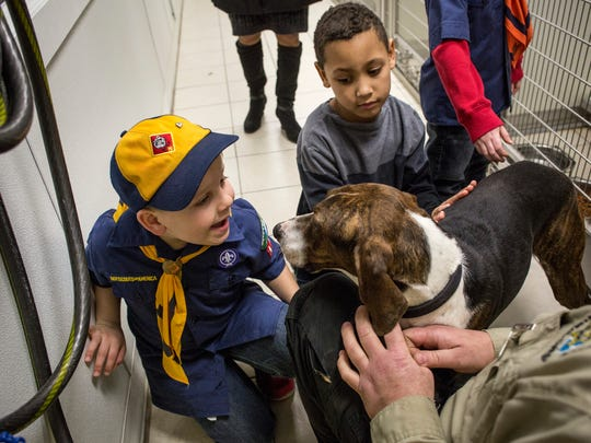 Indian Woods Cub Scout Pack 154 members Jacob Maiuri, 8, and Bradyn Hinton, 7, pet a dog Tuesday, March 1, 2016 at St. Clair County Animal Control.