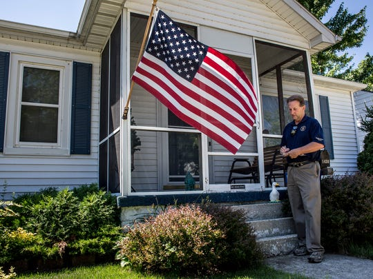 Alan Sanborn, of Richmond Township, walks door-to-door to promote his campaign Tuesday, July 26, 2016 on Sanborn Street in Port Huron. Sanborn, a republican, is running for Congress in Michigan's 10th Congressional District