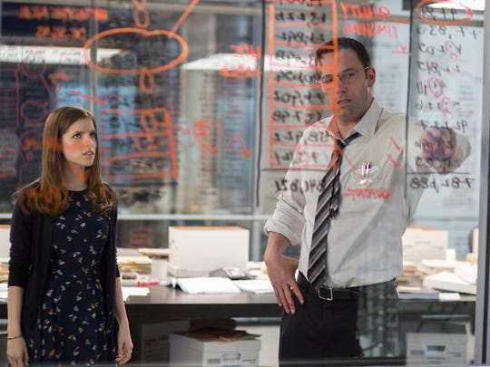 """Dana (Anna Kendrick) listens as Christian (Ben Affleck) talks about the bookkeeping he's done as """"The Accountant."""""""